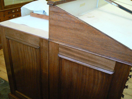 UV damaged shellac finish to cabinets in the sedgewick museum after treatment